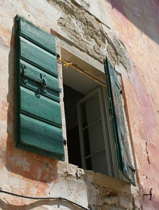 Old window with shutters