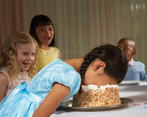 children-laughing-at-girl-with-face-in-cake.jpg