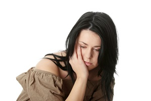 Young corpulent woman with depression