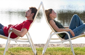 man-and-woman-lounging-with-backs-to-each-other