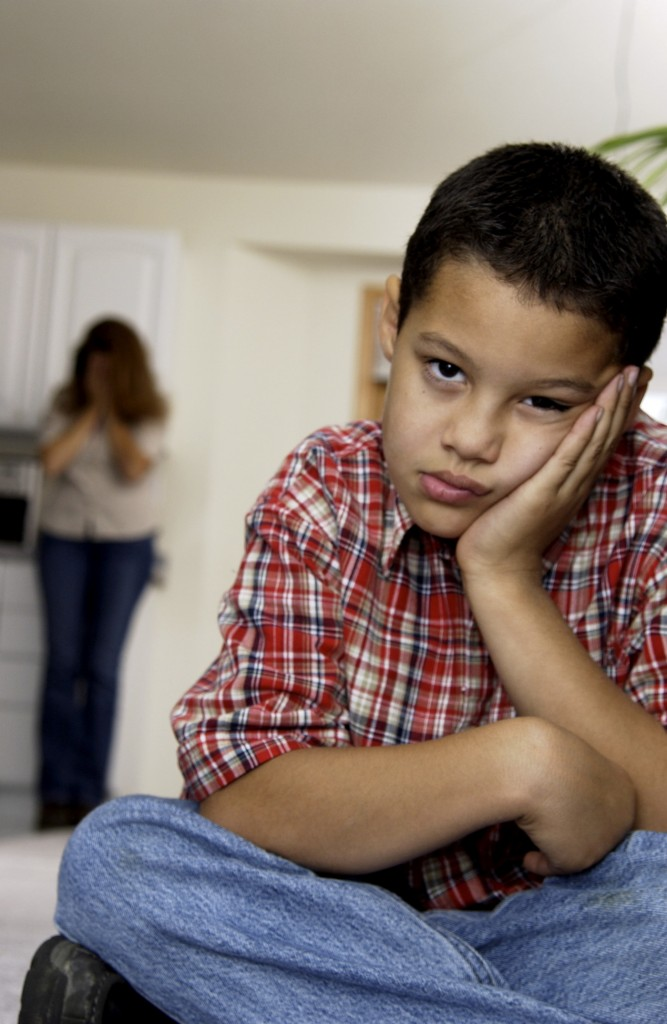 boy with frustrated mother in background