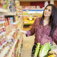 A shopper peruses shelves for a specific product