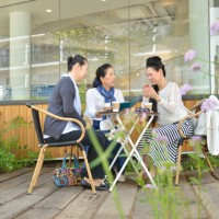 Three senior women talking at cafe