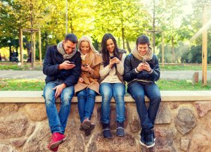 Young adults playing a game on their smartphones