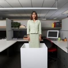A woman stands in a box.