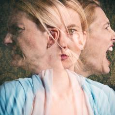 Multi-exposure photo of face with three different emotions