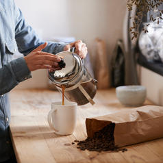 Person pouring coffee from french press