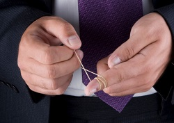A man tightens an elastic band around his finger