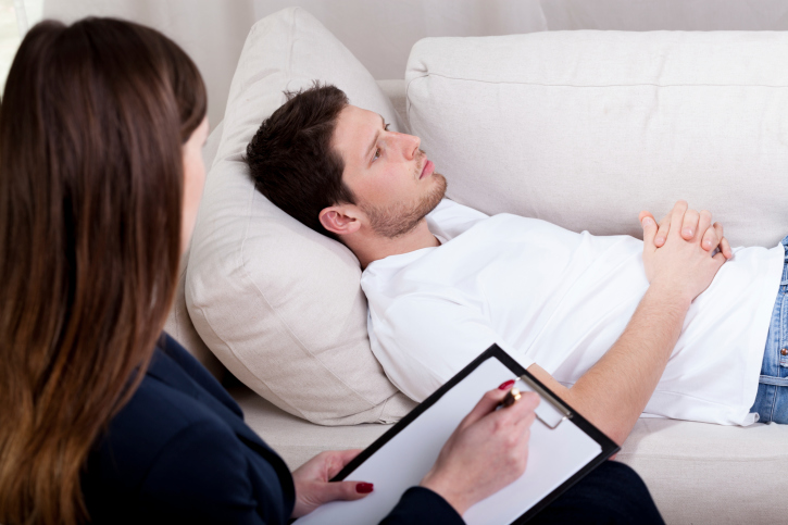 Therapist speaks to a client under hypnosis