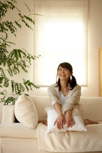 Girl sitting on couch smiling