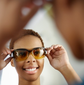 Young Woman Trying on Sunglasses