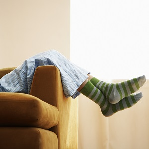 Person in pajamas resting on couch