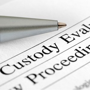"A close-up of a legal document titled, ""custody evaluation."""