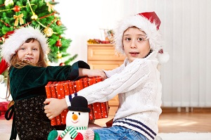 Kids fighting over Christmas present