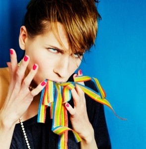 Woman with rainbow ribbons coming out of her mouth