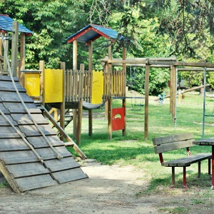 An inviting playground is shown on a sunny day.