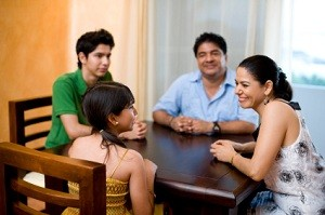 Family sitting around table talking