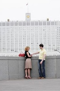 Couple near large building