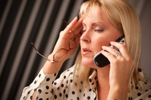 Stressed woman talking on phone