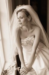 Thinking bride looking out window