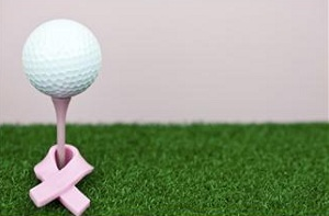 Golf tee with ball and breast cancer ribbon