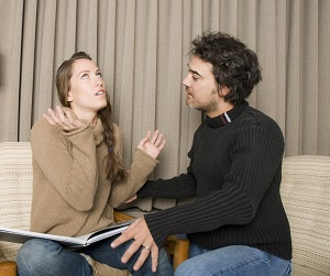 Annoyed woman and man talking