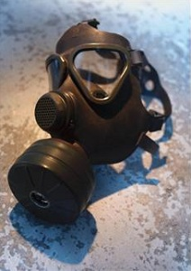 Gas mask sitting on cement