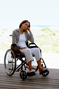 Woman in a wheelchair looking sad
