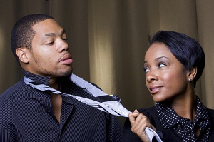 Woman tugging on man's tie