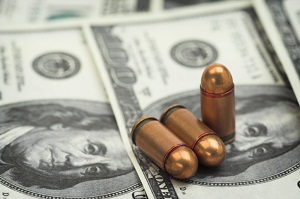 Bullets sitting on money