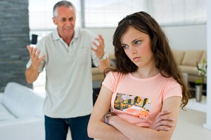 Father yelling at teen daughter