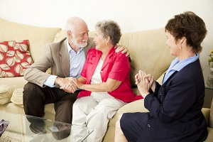 Happy older couple with therapist