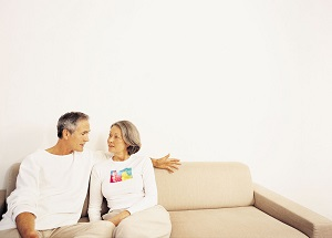 Older couple talking on couch