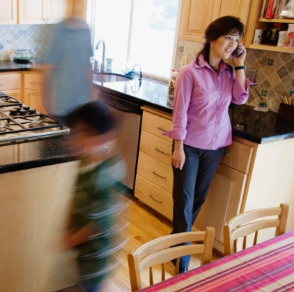Family members move around mom in kitchen