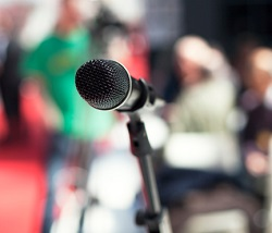 microphone in front of large crowd