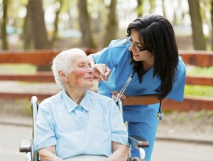 caring nurse with a senior patient