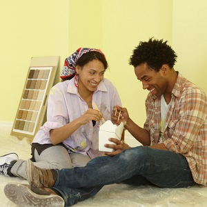 couple eating in painting room
