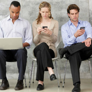 three people on electronic devices