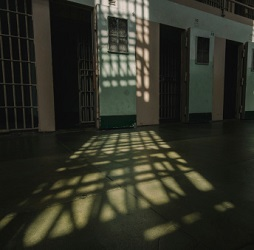 Sunlight floods an empty prison cell block