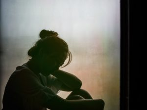 Silhouette of girl grieving