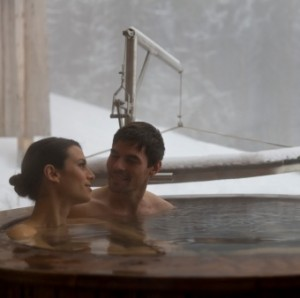 Couple in hot tub, outside