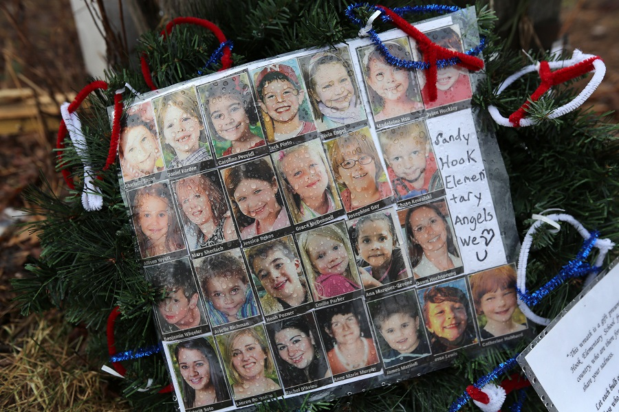 A memorial with photographs of victims of Sandy Hook shooting