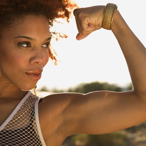 strong woman flexing bicep