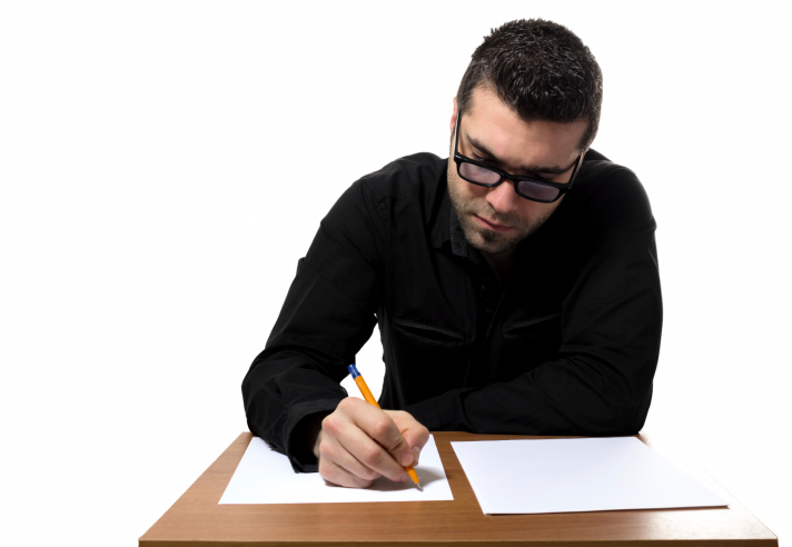 Man at desk completes written test