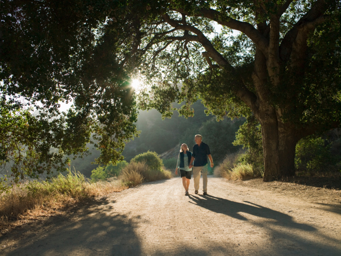 mature couple waking down dirt road