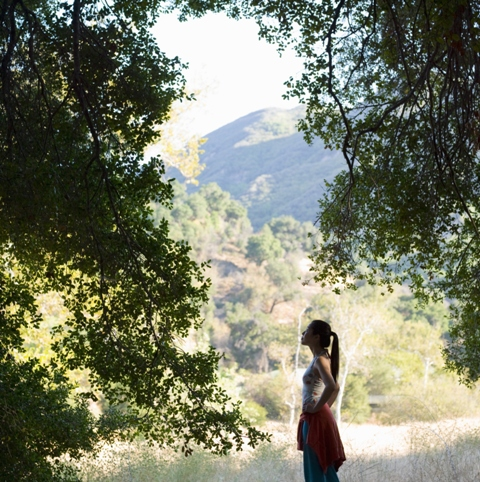 woman looks out at montains and trees