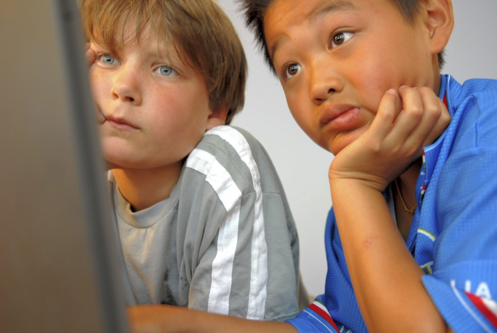 Two boys looking at a computer