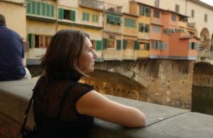 woman overlooking Italy river