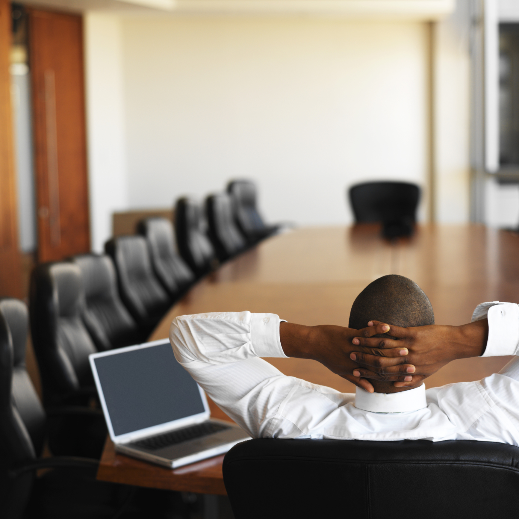 Businessman relaxing at table in conference room