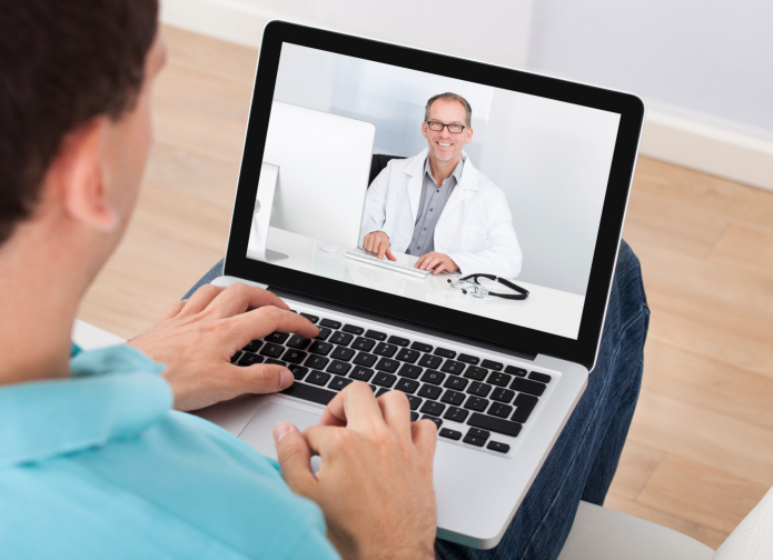 Man talking to therapist over video chat